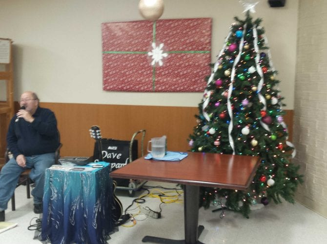 Entertainment Dave Sheppard by the dining room Christmas tree